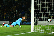 Simon Eastwood of Oxford United (1) is beaten by Jamie Murphy of Burton Albion (29) during the EFL Sky Bet League 1 match between Burton Albion and Oxford United at the Pirelli Stadium, Burton upon Trent, England on 11 February 2020.