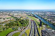Nederland, Utrecht, Leidsche Rijn, 30-09-2015; zuidelijk ingang van de Leidsche Rijntunnel en verkeersplein Hooggelegen, afslag Rijksweg 2 (A2) bij Leidse Rijn. Rechts Amsterdam-Rijnkanaal.<br /> Entrance land tunnel for motorway A2 and Hooggelegen junction near Utrecht.<br /> <br /> luchtfoto (toeslag op standard tarieven);<br /> aerial photo (additional fee required);<br /> copyright foto/photo Siebe Swart