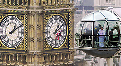 London Eye visitors get a birds-eye view of glazier Tony McCarty (C) on clock face, as he completes the finishing touches to replacing damaged  glass to the outside of Big Ben, London, as its massive clean up operation drew to a close.  * A glazier took a final leap from the top of the famous landmark to repair the glass on the clockface. Clinging to a single rope, Tony McCarthy attempted his first ever abseil to mend tiny cracks that had formed in the glass of the London landmark. Visitors to the nearby London Eye got a bird's eye view of the worker as he gingerly made his way around the enormous timepiece.