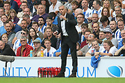 Manchester United Manager Jose Mourinho takes a drink during the Premier League match between Brighton and Hove Albion and Manchester United at the American Express Community Stadium, Brighton and Hove, England on 19 August 2018.