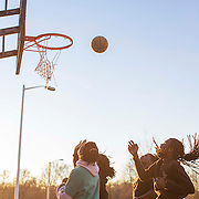 Local youth play basketball outside Billingsville Elementary School in Grier Heights.