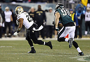 New Orleans Saints running back Mark Ingram (22) runs the ball during the NFL NFC Wild Card football game against the Philadelphia Eagles on Saturday, Jan. 4, 2014 in Philadelphia. The Saints won the game 26-24. ©Paul Anthony Spinelli