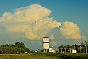 Thunderhead (cumulonimbus) clouds of approaching storm and grain elevator <br /> Dufresne<br /> Manitoba<br /> Canada