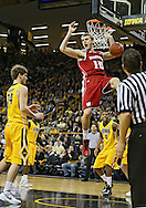 January 19 2013: Wisconsin Badgers forward Sam Dekker (15) dunks over Iowa Hawkeyes forward Aaron White (30) during the second half of the NCAA basketball game between the Wisconsin Badgers and the Iowa Hawkeyes at Carver-Hawkeye Arena in Iowa City, Iowa on Sautrday January 19 2013. Iowa defeated Wisconsin 70-66.