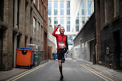 © Licensed to London News Pictures . 19/05/2019. Manchester, UK. A man warms up on a side street . The Great Manchester Run takes place in Manchester City Centre , starting at Portland Street . Photo credit : Joel Goodman/LNP