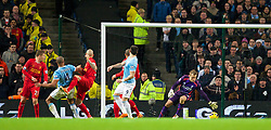 MANCHESTER, ENGLAND - Boxing Day Thursday, December 26, 2013: Manchester City's Vincent Kompany scores the first equalising goal against Liverpool during the Premiership match at the City of Manchester Stadium. (Pic by David Rawcliffe/Propaganda)