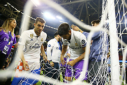 June 3, 2017 - Cardiff, Walles, United Kingdom - Mateo Kovacic and Alvaro Morata of Real Madrid cutting the network football goal after the award ceremony during the UEFA Champions League Final between Juventus and Real Madrid at National Stadium of Wales on June 3, 2017 in Cardiff, Wales. (Credit Image: © Matteo Ciambelli/NurPhoto via ZUMA Press)