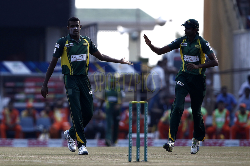Farveez Maharoof of the SOUTHERN EXPRESS celebrates the wicket of Ahmed Shehzad of the LAHORE LIONS during the qualifier 5 match of the Oppo Champions League Twenty20 between the Southern Express and the Lahore Lions held at the Chhattisgarh International Cricket Stadium, Raipur, India on the 16th September 2014<br /> <br /> Photo by:  Deepak Malik / Sportzpics/ CLT20<br /> <br /> <br /> Image use is subject to the terms and conditions as laid out by the BCCI/ CLT20.  The terms and conditions can be downloaded here:<br /> <br /> http://sportzpics.photoshelter.com/gallery/CLT20-Image-Terms-and-Conditions-2014/G0000IfNJn535VPU/C0000QhhKadWcjYs