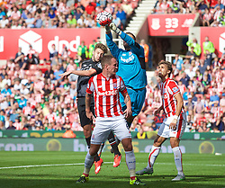 STOKE-ON-TRENT, ENGLAND - Sunday, August 9, 2015: Liverpool's Adam Lallana and Stoke City's goalkeeper Jack Butland during the Premier League match at the Britannia Stadium. (Pic by David Rawcliffe/Propaganda)