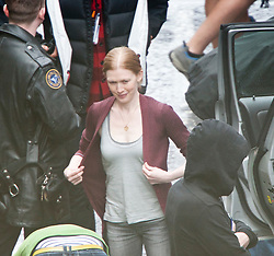 """Brad Pitt's co-star Mireille Enos on the set of the movie """"World War Z"""" being shot in the city centre of Glasgow. The film, which is set in Philadelphia, is being shot in various parts of Glasgow, transforming it to shoot the post apocalyptic zombie film."""