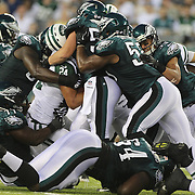 Jets Kahlil Bell is tackled in action during the first quarter of the New York Jets V Philadelphia Eagles Pre Season NFL match at MetLife Stadium, East Rutherford, NJ, USA. 29th August 2013. Photo Tim Clayton