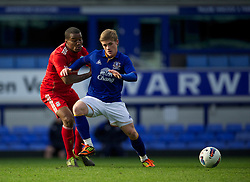 LIVERPOOL, ENGLAND - Tuesday, March 6, 2012: Liverpool's Stephen Sama in action against Everton's Conor McAlney during the FA Premier Reserve League match at Goodison Park. (Pic by David Rawcliffe/Propaganda)