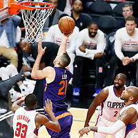 31 October 2016: Phoenix Suns center Alex Len (21) goes for the layup against Los Angeles Clippers forward Wesley Johnson (33) during the Los Angeles Clippers 116-98 victory over the Phoenix Suns, at the Staples Center, Los Angeles, California, USA.