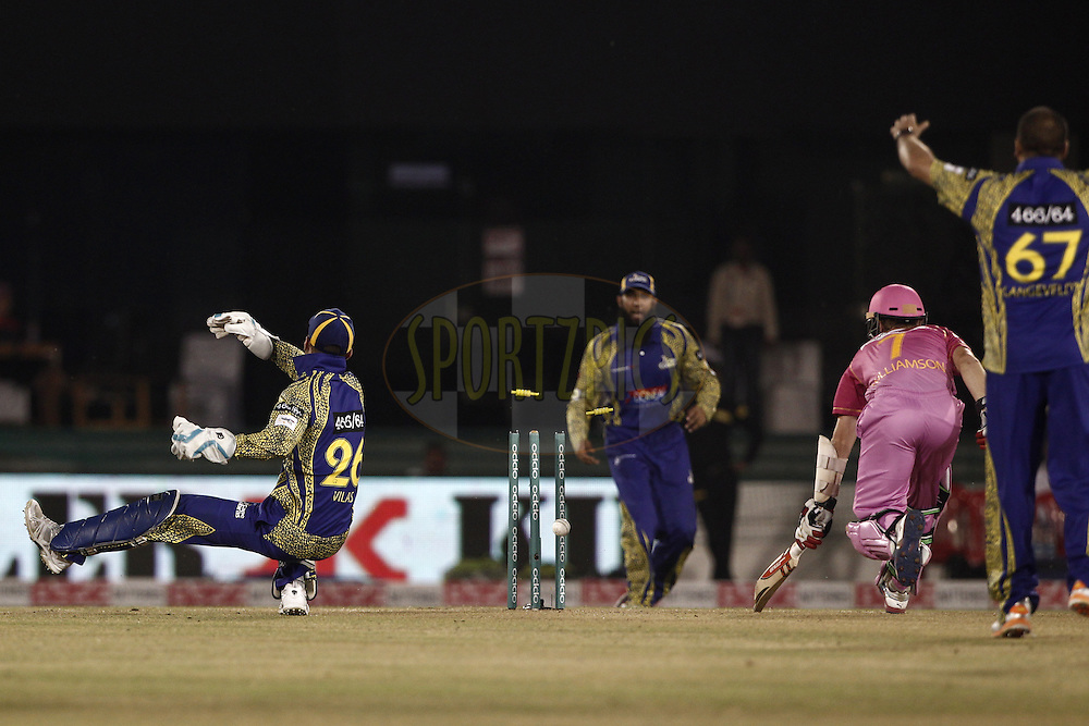 Dane Vilas of Cape Cobras trying to runout Kane Williamson of the NORTHERN KNIGHTS during match 3 of the Oppo Champions League Twenty20 between the Cape Cobras and the Northern Knights held at the Chhattisgarh International Cricket Stadium, Raipur, India on the 19th September 2014<br /> <br /> Photo by:  Deepak Malik / Sportzpics/ CLT20<br /> <br /> <br /> Image use is subject to the terms and conditions as laid out by the BCCI/ CLT20.  The terms and conditions can be downloaded here:<br /> <br /> http://sportzpics.photoshelter.com/gallery/CLT20-Image-Terms-and-Conditions-2014/G0000IfNJn535VPU/C0000QhhKadWcjYs
