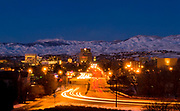 Magical view of Boise city skyline during winter twilight with snow covered foothill and beautiful blurred and starry lights.