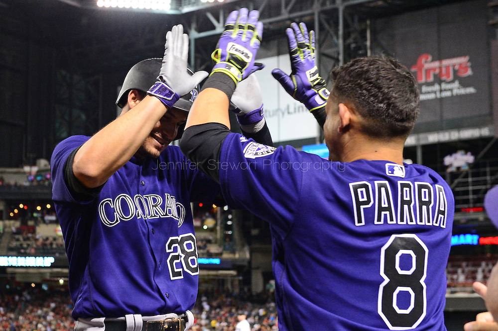 Apr 29, 2016; Phoenix, AZ, USA; Colorado Rockies third baseman Nolan Arenado (28) is congratulated Gerardo Parra (8) after hitting a solo home run against the Arizona Diamondbacks in the fifth inning at Chase Field. Mandatory Credit: Jennifer Stewart-USA TODAY Sports