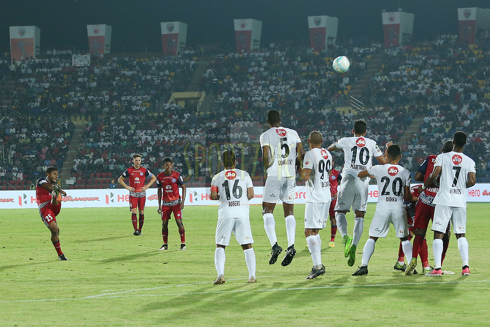 Izu Azuka of Jamshedpur FC takes the free kick during match 2 of the Hero Indian Super League between NorthEast United FC and Jamshedpur FC held at the Indira Gandhi Athletic Stadium, Guwahati India on the 18th November 2017<br /> <br /> Photo by: Ron Gaunt / ISL / SPORTZPICS
