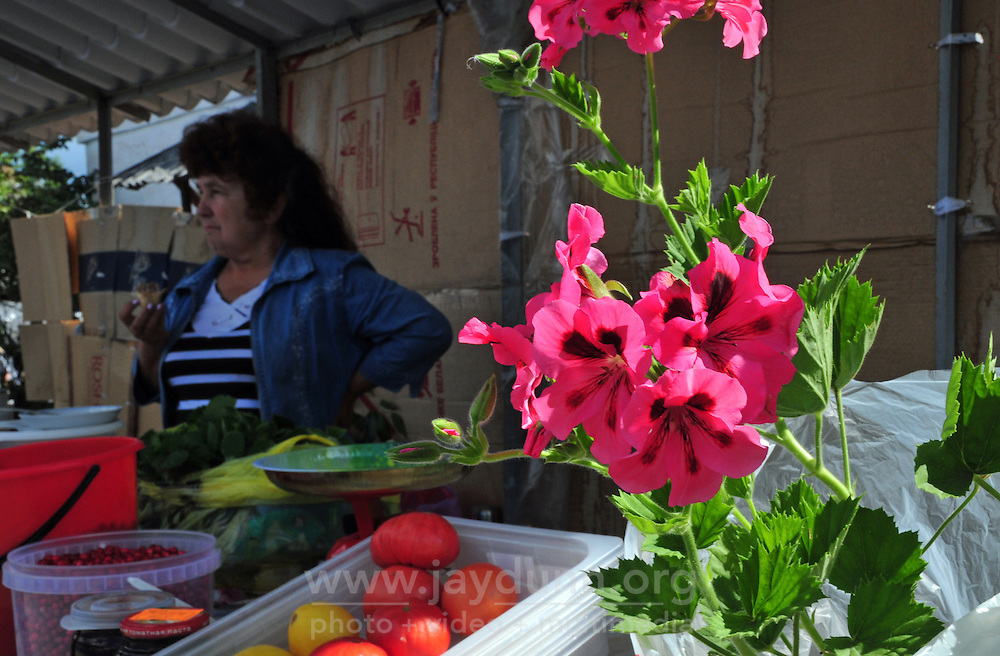 "With summer vegetables in hand, a stall owner at a local market  in Uglich, Russia waits for customers. As one of Russia's ""Golden Ring"" cities, Uglich is designated a town of significant cultural and historic importance."