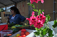 """With summer vegetables in hand, a stall owner at a local market  in Uglich, Russia waits for customers. As one of Russia's """"Golden Ring"""" cities, Uglich is designated a town of significant cultural and historic importance."""