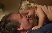 Father John Focht nuzzles his baby girl, Elli Rose in Memphis, Tennessee.