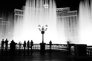 The Bellagio Hotel and Fountains along Las Vegas Boulevard in Las Vegas, Nevada.  The dynamic fountains are choreographed to music and they always draw a crowd of enchanted onlookers..