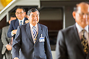 08 AUGUST 2014 - BANGKOK, THAILAND:       NLA members, including Air Chief Marshal THONGCHAI CHALAEMKHET (center) arrive at the parliament building in Bangkok. The Thai National Legislative Assembly (NLA) met Friday at the Parlimanet Building in Bangkok to elect legislative leadership. The NLA was appointed by the Thai junta, formally called the National Council for Peace and Order (NCPO), and is supposed to guide Thailand back to civilian rule after a military coup overthrew the elected government in May. There are 197 members of the NLA. Membership is tilted towards military personnel. From the Royal Thai Army 40 members are Generals, 21 are Lt. Generals and 7 are Major Generals. From the Royal Thai Air Force 17 are Air Chief Marshals and 2 are Air Marshals. From the Royal Thai Navy, 14 are Admirals and 5 are Vice Admirals. There are also 6 Police Generals and 3 Police Lt. Generals. There are 187 men in the NLA and only 10 women.  PHOTO BY JACK KURTZ