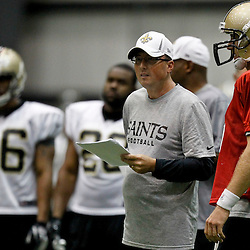 July 27, 2012; Metairie, LA, USA; New Orleans Saints offensive coordinator Pete Carmichael talks with quarterback Drew Brees (9) during training camp at the team's indoor practice facility. Mandatory Credit: Derick E. Hingle-US PRESSWIRE