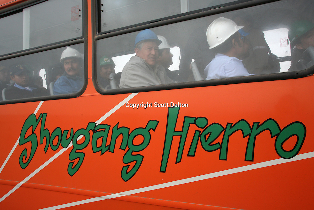 A bus full of workers arrive to the entrance of the Shougang iron mine, a Chinese owned and operated mine, just outside of Marcona, in southern Peru on October 25, 2007. (Photo/Scott Dalton)