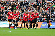 Man Utd's Patrice Evra © celebrates with teammates after he scores the opening goal. Barclays premier league, Swansea city v Manchester Utd at the Liberty stadium in Swansea, South Wales on Sunday 23rd Dec 2012. pic by Andrew Orchard, Andrew Orchard sports photography,