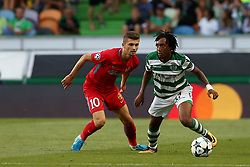 August 15, 2017 - Lisbon, Portugal - Sporting's forward Gelson Martins from Portugal (R ) vies with Steaua's forward Florin Tanase during the UEFA Champions League play-offs first leg football match between Sporting CP and FC Steaua Bucuresti at the Alvalade stadium in Lisbon, Portugal on August 15, 2017. (Credit Image: © Pedro Fiuza/NurPhoto via ZUMA Press)