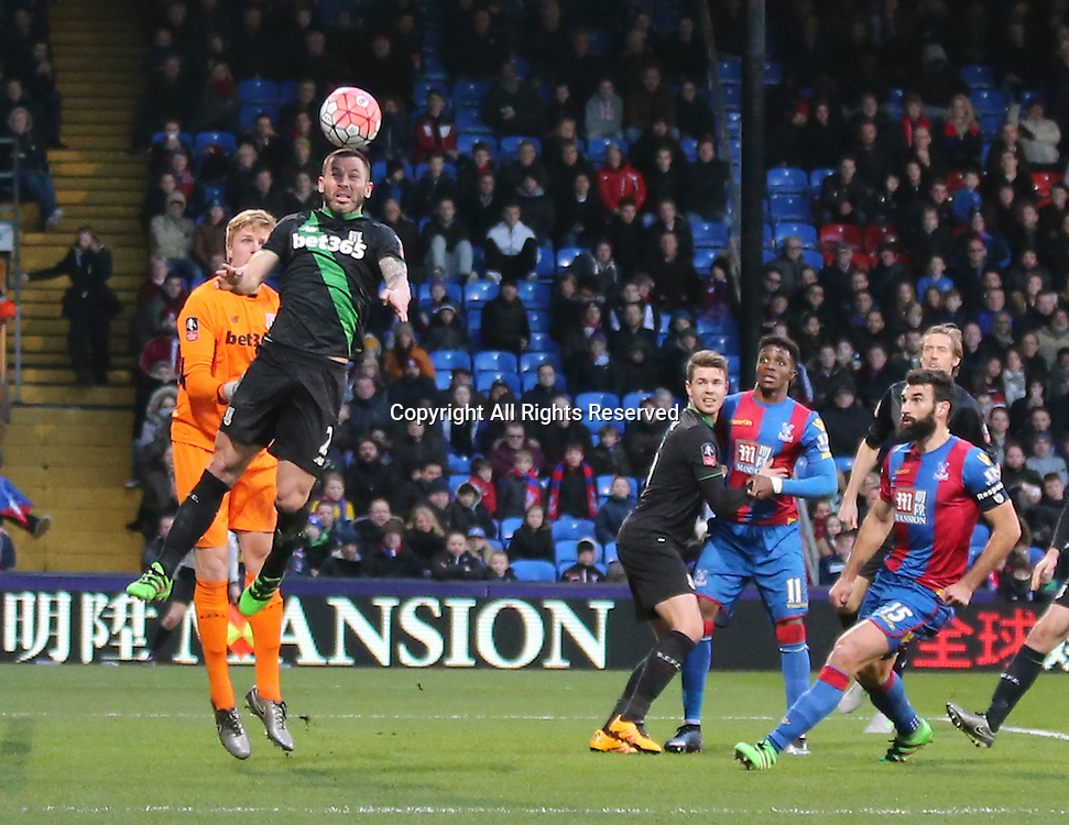 30.01.2016. Selhurst Park, London, England. Emirates FA Cup 4th Round. Crystal Palace versus Stoke. Phil Bardsley heads away from a corner