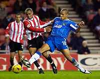 Photo. Jed Wee.<br /> Sunderland v Wigan Athletic, Nationwide League Division One, Stadium of Light, Sunderland. 02/12/03.<br /> Sunderland's Jeff Whitley (L) is tackled by Wigan's Jason Jarett.