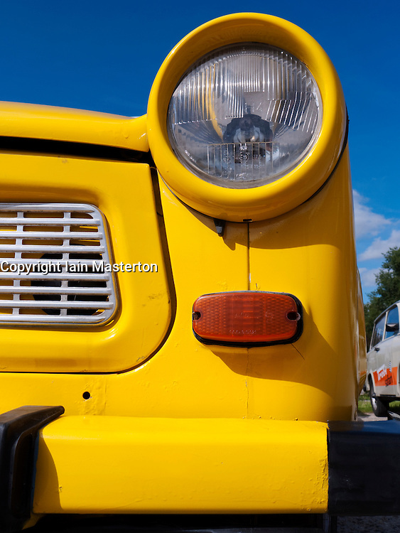 Detail of yellow Old East German era Trabant cars in Berlin Germany