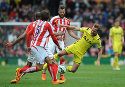 Stoke City's Erik Pieters fouls Tottenham Hotspur's Harry Kane - Photo mandatory by-line: Dougie Allward/JMP - Mobile: 07966 386802 - 09/05/2015 - SPORT - Football - Stoke - Britannia Stadium<br />  - Stoke v Tottenham Hotspur - Barclays Premier League