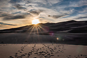 Sunset. Dunes rise up to 750 feet tall in Great Sand Dunes National Park and Preserve, on the eastern edge of San Luis Valley, Sangre de Cristo Range, south-central Colorado, USA.