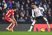 Derby County midfielder Tom Ince (10) holds off Bristol City defender Scott Golbourne (13) during the EFL Sky Bet Championship match between Derby County and Bristol City at the Pride Park, Derby, England on 11 February 2017. Photo by Jon Hobley.