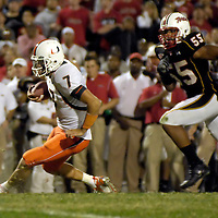 11 November 2006:  Miami University quarterback Kirby Freeman (7) runs for a 6-yard gain and a first downin the 4th quarter against University of Maryland defensive end Trey Covington (55).  The Maryland Terrapins defeated the Miami University Hurricanes 14-13 at Byrd Stadium in College Park, Maryland.