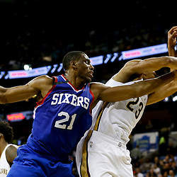 Nov 16, 2013; New Orleans, LA, USA; Philadelphia 76ers power forward Thaddeus Young (21) and New Orleans Pelicans power forward Anthony Davis (23)  battle for a rebound during the first half of a game at New Orleans Arena. Mandatory Credit: Derick E. Hingle-USA TODAY Sports