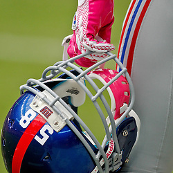 October 10, 2010; Houston, TX USA; New York Giants linebacker Gerris Wilkinson (58) holds his helmet on the sideline prior to kickoff of a game against the Houston Texans at Reliant Stadium. In support of breast cancer awareness month player wore pink colored equipment.  Mandatory Credit: Derick E. Hingle