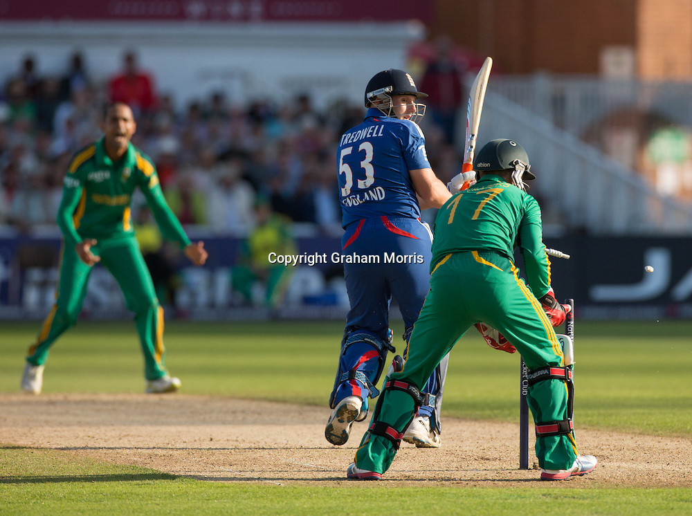 James Tredwell is bowled by Robin Petersen during the fifth and final NatWest Series one day international between England and South Africa at Trent Bridge, Nottingham. Photo: Graham Morris (Tel: +44(0)20 8969 4192 Email: sales@cricketpix.com) 05/09/12