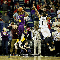 Feb 1, 2016; New Orleans, LA, USA; New Orleans Pelicans guard Norris Cole (30) shoots over Memphis Grizzlies guard Mike Conley (11) during the first quarter of a game at the Smoothie King Center. Mandatory Credit: Derick E. Hingle-USA TODAY Sports