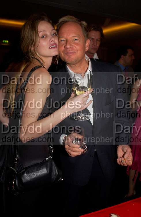 Natasha Vermeer and Tony Hickox.  Andy & Patti Wong's Chinese New Year party to celebrate the year of the Rooster held at the Great Eastern Hotel, Liverpool Street, London.29th January 2005. The theme was a night of hedonism in 1920's Shanghai. . ONE TIME USE ONLY - DO NOT ARCHIVE  © Copyright Photograph by Dafydd Jones 66 Stockwell Park Rd. London SW9 0DA Tel 020 7733 0108 www.dafjones.com