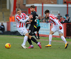 Cheltenham Town's Zack Kotwica  and Cheltenham Town's Eliot Richards challenges for the ball against  Bury's Joe Riley- Photo mandatory by-line: Nizaam Jones - Mobile: 07966 386802 - 14/02/2015 - SPORT - Football - Cheltenham - Whaddon Road - Cheltenham Town v Bury - Sky Bet League Two