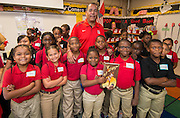 University of Houston basketball coach Kelvin Sampson poses for a photograph with students during the Read for the NCAA Final Four kick-off at Blackshear Elementary School, September 24, 2015.