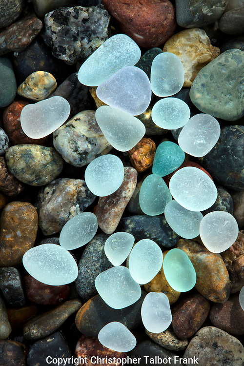 I set my camera up on a tripod to get a high end detailed photo of natural sea glass on a cobblestone beach.  The colors glow from the side lit little gems.