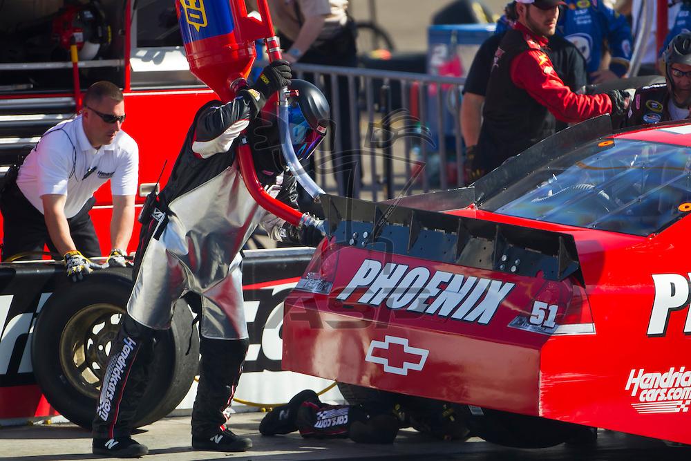 AVONDALE, AZ - MAR 04, 2012:  Kurt Busch (51) brings his Phoenix Chevrolet in for service during the Subway Fresh Fit 500 race at the Phoenix International Raceway in Avondale, AZ.