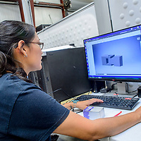 Wynona Wilson looks over a three dimensional model in the Navajo Technical University manufacturing lab in Crownpoint Thursday.