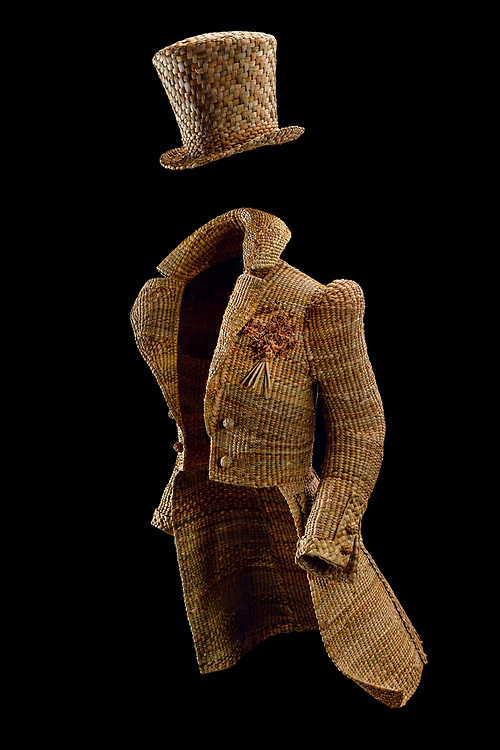 Hand-made C19th dress-coat and top hat. Woven in fresh-water Bulrush, by Rachel Frost, who is based in the Scottish Borders. <br /> <br /> Rachel Frost graduated from Edinburgh College of art with an honours degree in Model Animation. After initially working for Jim Hensons Creature shop, she set up her own business &quot;The Crafty Beggars&quot; , providing bespoke hand crafted items in a variety of traditional craft disciplines for the Heritage industry. She is a leading authority on the subject of historical felt-hat making techiques with her hand-felted hats held in collections world wide. <br /> www.thecraftybeggars.org
