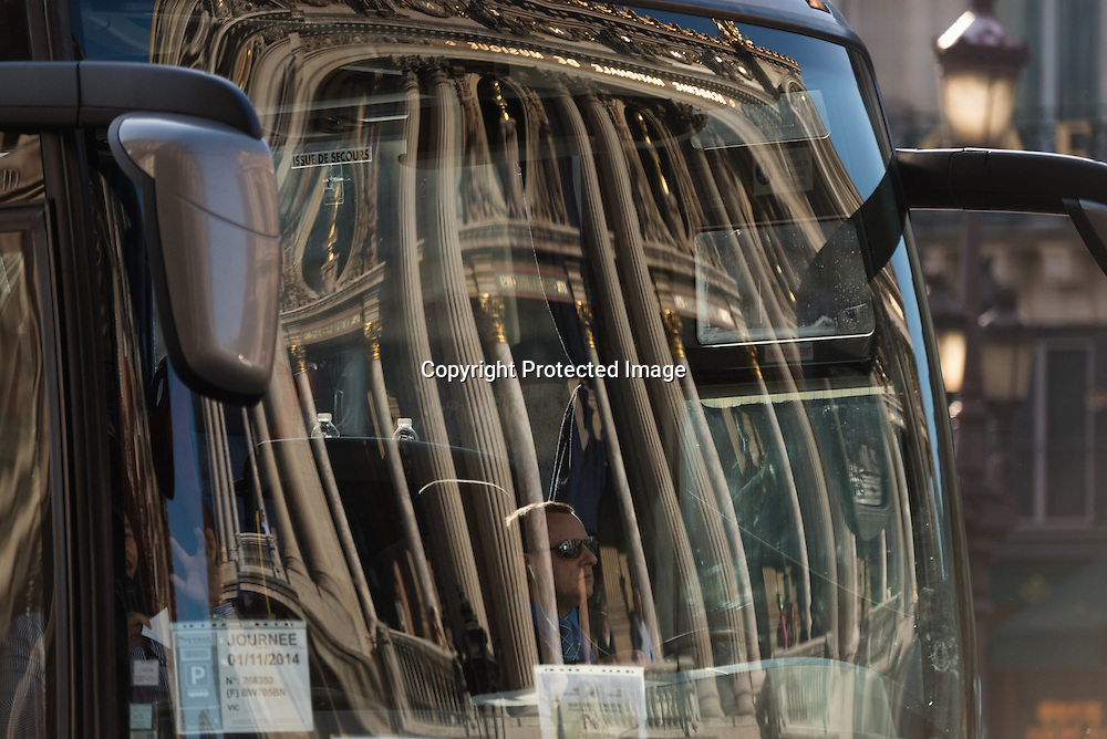 Paris, The Opera garnier , reflected on a bus.