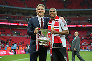 Bastian Schweinsteiger of Manchester United and Ashley Young of Manchester United with the FA Cup during the The FA Cup Final between Crystal Palace and Manchester United at Wembley Stadium, London, England on 21 May 2016. Photo by Phil Duncan.